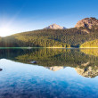 Reflection in water of mountain lake — Stock Photo