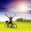 Biker tourist relaxation in green field — Stock Photo