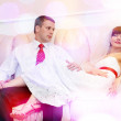Bride and groom relax on the sofa — Stock Photo