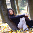 Woman sitting in park — Stock Photo