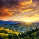 Beautiful green hills at dusk — Stock Photo #49158783