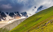 Alpine meadows with dramatic sky — Stock Photo