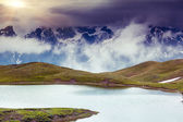 Landscape with lake and overcast sky — Stock Photo