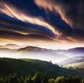Milky Way over the mountains landscape — Stock fotografie