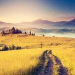 Sunny hills under morning sky — Stock Photo #49312293