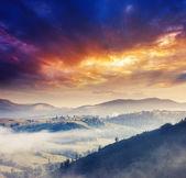 Sunny hills under cloudy sky — Stock Photo