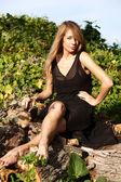 Young beautiful women sitting on the wood. — Stock Photo
