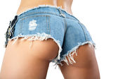 Sexy woman body in jean shorts. — Stockfoto
