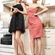 Two girls in the style of 60's in the kitchen. — Stock Photo