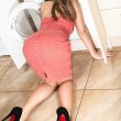 The woman put her head in the washing machine. — Stock Photo