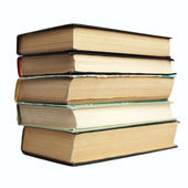 Fragment pile of old books on white background. — Stock Photo