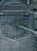 Blue jeans with pocket to background. — Stock Photo