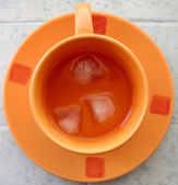 Orange cup with juice. — Stock Photo