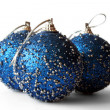 New Year decoration blue balls on the white background. — Stock fotografie