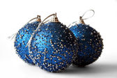 New Year decoration blue balls on the white background. — Stock Photo