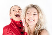 Blonde girl whispering to a friend against white background. — Stok fotoğraf