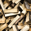 Firewood background - chopped firewood on a stack. — Stock Photo