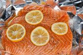 Salmon with orange slices — Stock Photo