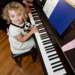 Girl with a piano — Stock Photo