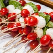 Mozzarella, Cherry Tomato and Basil Skewers — Stock Photo #27987673