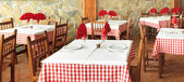 Rustic restaurant tables — Stock Photo