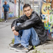 Man in graffiti background — Stock Photo