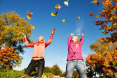 Happy Women at autumn outdoors — Stock Photo