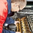 Machanic repairman at automobile car engine repair — Stock Photo