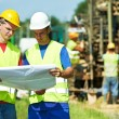 Royalty-Free Stock Photo: Engineers builders at road works construction site