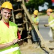 Smiling Engineer builder at road works site — Stock Photo #12626654