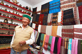 Small shop owner indian man at his souvenir store — Stock Photo