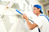 Painter at home renovation work with prime — Stock Photo
