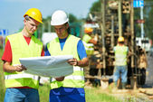 Engineers builders at road works construction site — Stock Photo