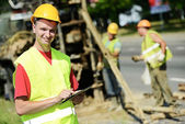 Smiling Engineer builder at road works site — Stock Photo