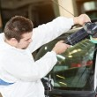 Auto mechanic polishing car — Stock Photo #12723402