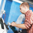 Stock Photo: Auto mechanic polishing car