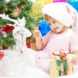 Little girl with gifts at Christmas or new year — Stock Photo #12763106