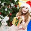 Little girl with gifts at Christmas or new year — Stock Photo #12763280