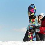 Happy sportswoman with snowboard — Stock Photo