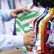 Close-up hands choosing clothing — Stock Photo #12792293