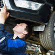 Auto car repair mechanic at work - Stock Photo