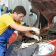 Auto mechanic at work with wrench — Stock Photo