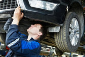 Auto car repair mechanic at work — Stock Photo
