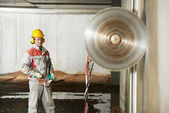 Builder worker operating demolition machine — Stock Photo