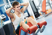 Bodybuilding man at abdominal crunch exercises — Stock Photo