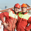 Happy builder workers at construction site — Stock Photo