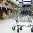 Shopping cart trolley in warehouse — Stock Photo #13873521