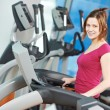 Stock Photo: Positive womat cardio training simulator