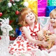 Little girls with gifts at Christmas or new year — Stock Photo