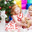 Little girls with gifts at Christmas or new year — Stockfoto